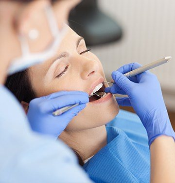 Relaxed woman receiving dental exam