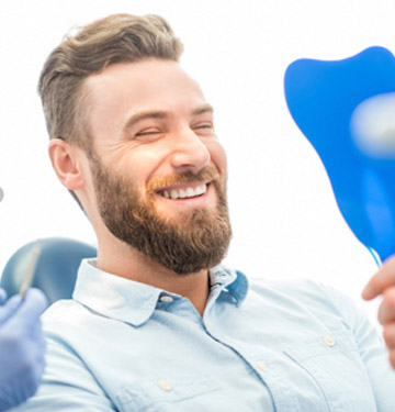 Man smiling in dentist's chair