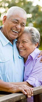 Laughing older man and woman outdoors