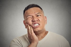 pained man should see his Farmington Hills emergency dentist